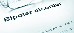 Bipolar disorder sign on a paper and glasses.